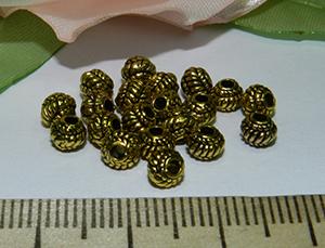 Бусина металлическая золотистая с рисунком 5х4мм Zol_02