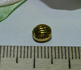 Бусина металлическая золотистая с рисунком 6х5мм Zol_07